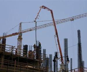 Construction cranes and a boom for pouring cement dot the Hollywood skyline in this 2008 file photo.
