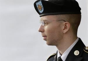 Army Pfc. Bradley Manning is escorted to a security vehicle outside a courthouse in Fort Meade, Md., on July 18.