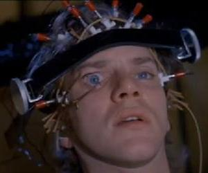 Alex gets his switch turned on the hard way in this screenshot from A Clockwork Orange.