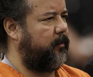 In this Wednesday, July 17, 2013, file photo shows Ariel Castro standing before a judge during his arraignment in Cleveland.