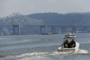 Rescue workers search the Hudson River for the missing bridal party.