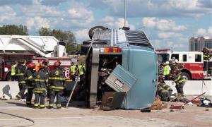 Firefighters work to extricate people from the bus crash in Indianapolis.