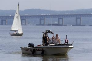 Rescue workers on a boat search the Hudson River south of the Tappan Zee Bridge for two people who are believed to have fallen into the water during a boat crash in Piermont, N.Y. on Saturday, July 27, 2013. Two people are missing and four others are injured after...