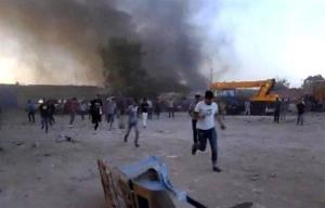 Libyans run for cover during earlier clashes in Benghazi.