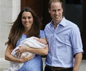 In this July 23, 2013 photo, Britain's Prince William and Kate, Duchess of Cambridge pose with the Prince of Cambridge outside St. Mary's Hospital in London.