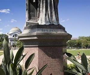 Green paint is seen on the pedestal of the statue of Joseph Henry, outside the headquarters of the Smithsonian Institution on the National Mall in Washington.