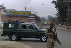 Pakistani army troops in Dera Ismail Khan, Pakistan, site of a mass jailbreak Monday night.