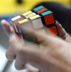 A participant solves a Rubik's Cube for speed during the 2010 Rubik's Cube Megahouse cup championship in Tokyo.