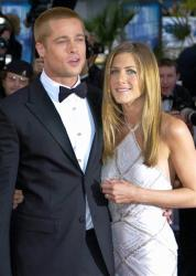In this May 13, 2004 file photo, Brad Pitt arrives with Jennifer Aniston at the screening of his film Troy at Cannes.