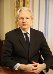 WikiLeaks founder Julian Assange sits inside the Ecuadorian embassy in London.
