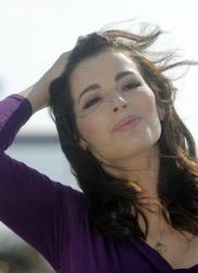 In this Tuesday, Oct. 9, 2012 file photo, Nigella Lawson poses during the 28th MIPCOM (International Film and Programme Market for TV, Video, Cable, and Satellite) in Cannes, southeastern France.