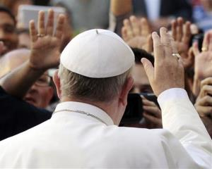 Pope Francis waves to faithful upon his arrival to the Church of Jesus to celebrate a mass, in Rome, Wednesday, July 31, 2013.
