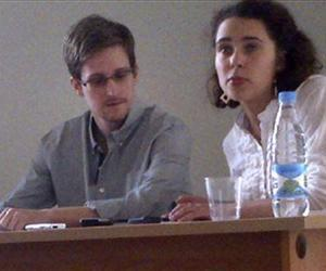 In this image provided by Human Rights Watch, NSA leaker Edward Snowden, center, attends a news conference at Moscow's Sheremetyevo Airport with Sarah Harrison of WikiLeaks, July 12, 2013.