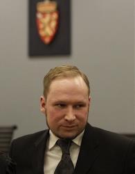 Anders Behring Breivik leaves a courtroom in Oslo in 2012.