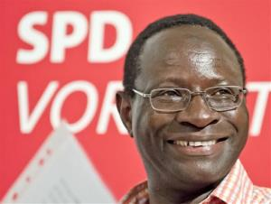 Karamba Diaby, a German Social Democratic Party candidate, smiles during an campaign stop in Halle , central Germany, Thursday.