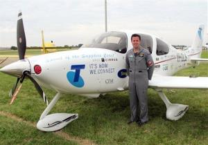 Ryan Campbell  stands in front of his plane.
