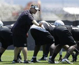In this June 11, 2013, file photo, Oakland Raiders defensive coordinator Jason Tarver gestures during practice at an NFL football training camp in Alameda, Calif.