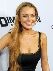 This April 11, 2013 file photo shows actress Lindsay Lohan, a cast member in Scary Movie V, at the premiere of the film in Los Angeles.