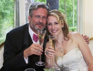 This Sunday, Aug. 5, 2012 photo released on behalf of Dr. William and Christine Petit shows the couple at a reception in Simsbury, Conn., after their wedding in West Hartford, Conn.