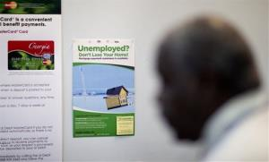 An unemployment assistance poster hangs in a Georgia Department of Labor career center, July 18, 2013, in Atlanta.