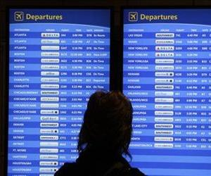This Oct. 31, 2012 file photo shows a passenger checking the departures board at Pittsburgh International Airport in Imperial, Pa.