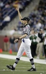 In this 2009 photo, line judge Sarah Thomas works an NCAA game.
