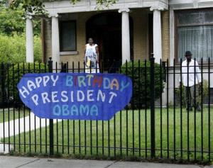 A sign wishing President Obama happy birthday hangs on a neighbor's fence near his Hyde Park home, Sunday, Aug. 12, 2012, in Chicago.