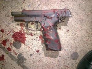The NYPD released this photo of a bloodied Astra A 100 9mm semi-automatic found at the scene.