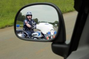 A police officer has pulled you over; civil forfeiture may ensue.