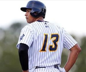 Alex Rodriguez stands on first base after drawing a walk during the first inning of a Class AA baseball game with the Trenton Thunder, Aug. 3, 2013.