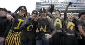 University of Iowa students react before an NCAA college football game against Penn State in Iowa City, Iowa.