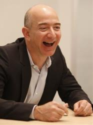 Amazon CEO Jeff Bezos laughs during an interview.