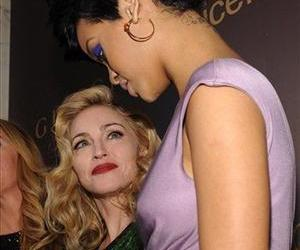 Singers  Madonna, left, looks at  Rihanna as they attend a Gucci UNICEF dinner at The Oak Room at the Plaza on Wednesday, Nov. 19, 2008 in New York.