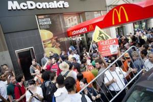Demonstrators in support of fast food workers protest outside a McDonald's Monday, July 29, 2013, in New York's Union Square.