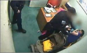 An officer moves in on Brandie Redell.