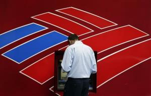 A customer uses a Bank of America  ATM in downtown Charlotte, N.C., Tuesday, July 16, 2013.