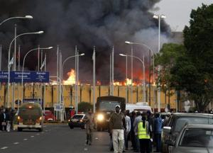 Black smoke billows from the international arrival unit  of Jomo Kenyatta International Airport in Nairobi, Kenya.
