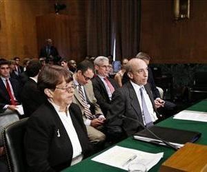 Securities and Exchange Commission (SEC) Chair Mary Jo White, left, and Commodity Futures Trading Commission (CFTC) Chairman Gary Gensler testify on Capitol Hill in this file photo.