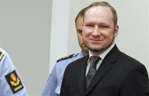 Anders Behring Breivik smiles as he arrives in court in 2012.