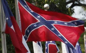 Confederate battle flags fly outside the museum at the Confederate Memorial Park.