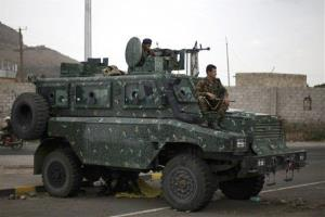 Police in an armored vehicle secure a road leading to the U.S. embassy in Sanaa, Yemen, Tuesday, Aug. 6, 2013, after non-essential personnel were ordered to leave the country.