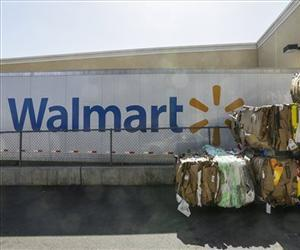 In this May 28, 2013, file photo, recycled cardboard boxes are ready for transport outside a Walmart store in Duarte, Calif.