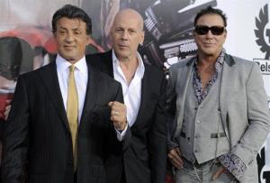 Sylvester Stallone, left, Bruce Willis, center, and Mickey Rourke, cast members in The Expendables, pose together at the premiere of the film in Los Angeles, Tuesday, Aug. 3, 2010.
