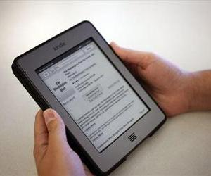 The Washington Post for Kindle application is displayed for purchase on an Amazon Kindle in New York, Aug. 5, 2013.