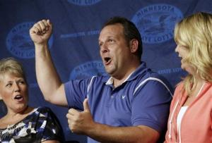 Paul White, of Ham Lake, Minn. accompanied by his girlfriend  Kim VanRees, right, lets out a holler during a news conference on Thursday, Aug. 8, 2013 in Minneapolis.