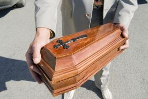 A wooden coffin for a dead animal.