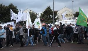 A Irish Republican parade makes its way through the center of Belfast Friday.