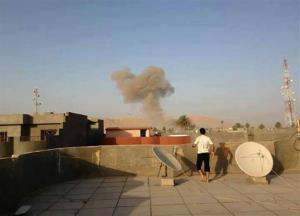 Smoke rises after a bomb attack in Tuz Khormato, 130 miles north of Baghdad, Iraq.