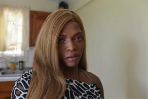 In this Aug. 3, 2013 photo, Dwayne Jones' transgendered friend and roommate, Keke, poses for a photo in kitchen of the home they shared on the northern outskirts of Montego Bay, Jamaica. International advocacy groups often portray this Caribbean island as the most hostile country in the Western Hemisphere for...