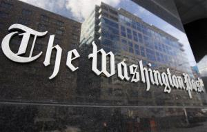 The Washington Post sign is seen on its building in Washington.
